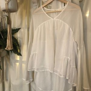 Asymmetrical White blouse with bell sleeves